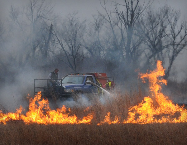 Water truck controlling a prairie burn